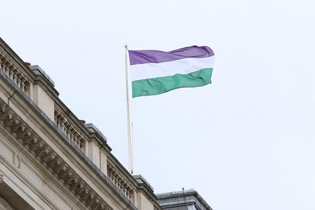 The Suffrage flag flies on the Foreign Office building in London