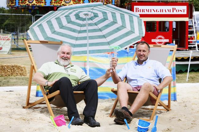 Graham Appleby (left) of Notcutts Nuneham Courtenay and Perrin Hatwell of Hatwell Brothers Funfair chill out at the garden centre's landlocked beach. 		      Picture: Ed Nix