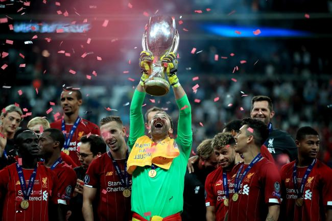 Liverpool's goalkeeper Adrian celebrates victory with the trophy