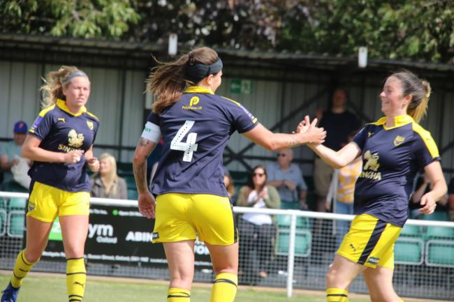 Oxford United captain Lauren Haynes (4) celebrates her goal during their friendly against Abingdon United with (right) Steph Mobbs and Georgia Clifford Picture: Darrell Fisher
