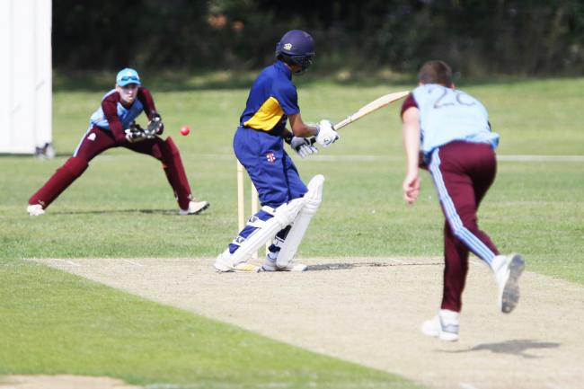 Wicket-keeper Callum Russell keeps his eyes on the ball as he takes this delivery from Johannes Van Dyk during Thame Town's victory over Dinton in the Home Counties Premier League Picture: Ed Nix