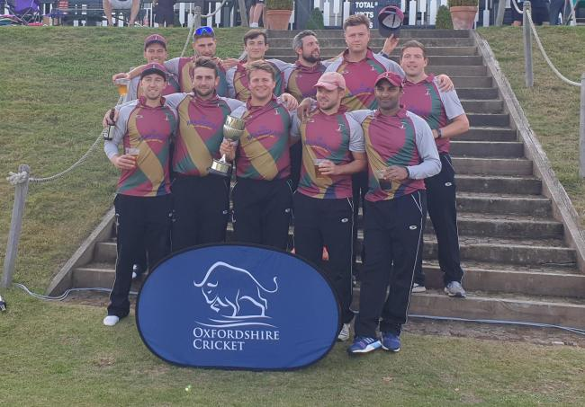 The victorious Banbury side celebrate their Bernard Tollett Cup success