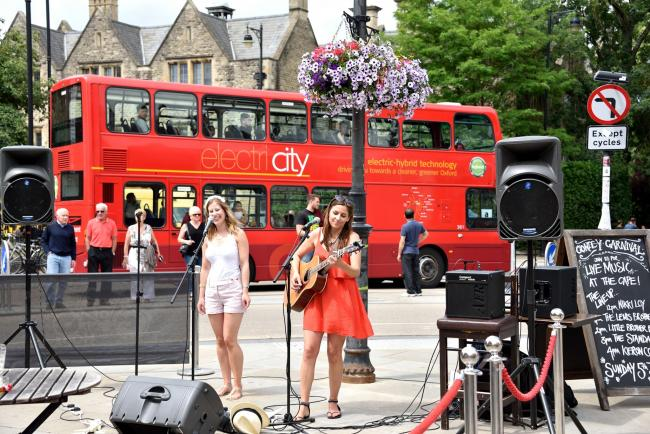 Oxford singer songwriter Nikki Loy (in red) performs in front of the Cape of Good Hope pub on The Plain, Oxford. Picture: Anthony Morris