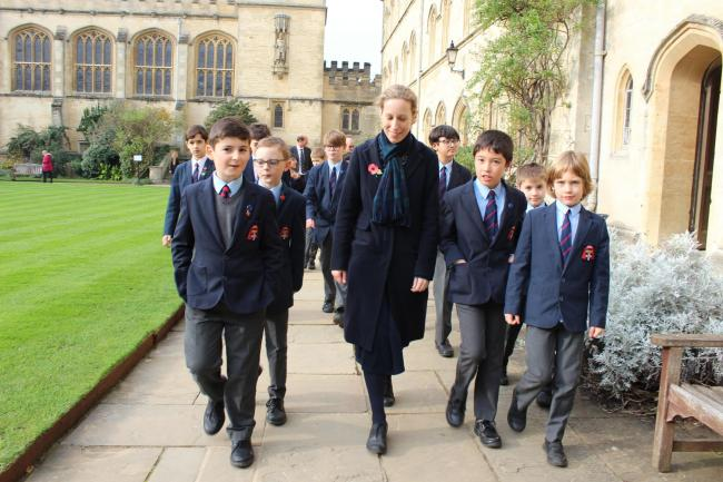 The boys walking through the quad with Ms Sophie Biddell at Pembroke College