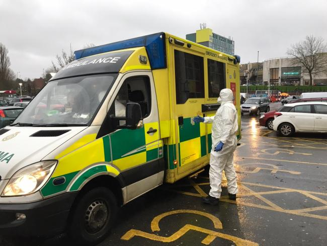 CORONAVIRUS 'fears' as paramedics seen in protective suits in Cowley