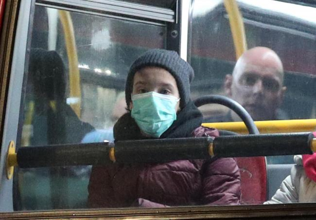 A person wearing a face mask on a bus in London. Picture: Yui Mok/PA Wire.