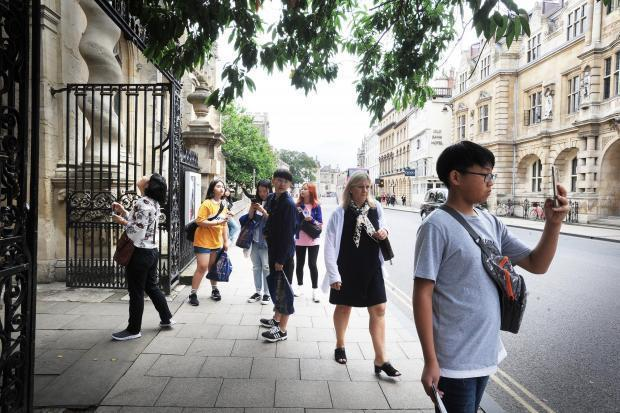Tourists in Oxford High Street before the coronvirus struck