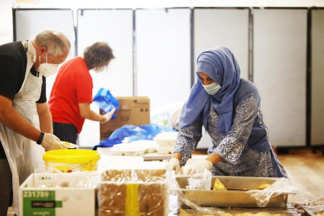 Volunteers from Oxford Mutual Aid help pack hot meals for the Grand Iftar feast of Ramadan. The group has seen its operation grow since it was formed in early March       Picture: Ed Nix