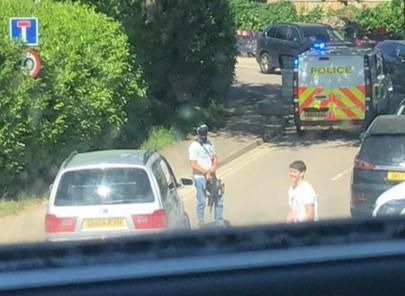 Police ram car off Saunders Road while armed police raid two neighbouring homes