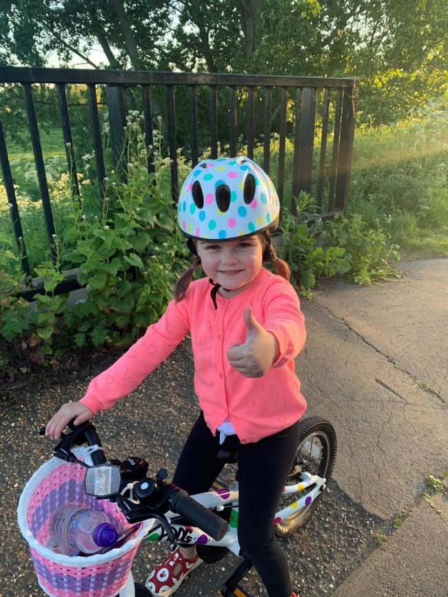Four-year-old Nellie on her bike