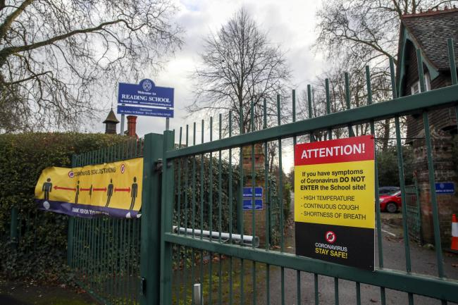 Coronavirus signs on the gates of Reading School in Reading
