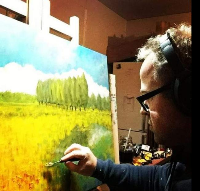 Darren Hall painting at his home in Carterton