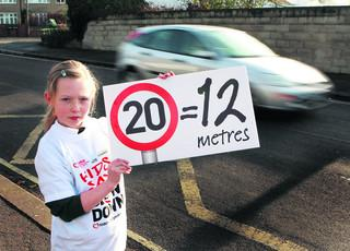 Ella Gray, eight, hopes drivers outside Windmill Primary School, Oxford, get the message about speed