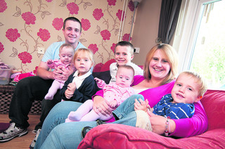Barton couple marry after miracle twins survive
