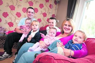 Pictured from left, Ruby, dad Daniel, Ella, four, Josh, six, Megan, mum Sarah and Tyler, two