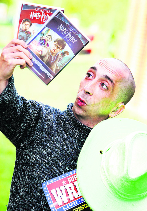 Mark Sealey, aka 'Little Legs' in the wrestling world, with DVDs of two of the Harry Potter films he has appeared in