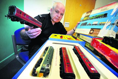 Pc Steven Pedley with the model trains found under a hedge at The Cherwell School