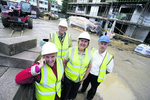Local residents Gill Clarke, left, with husband Bob, city councillor Ruth Wilkinson and construction site manager Ray Weston at the development