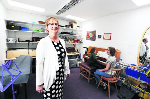 thisisoxfordshire: Headteacher Sue Tomkys, left, stands by as Hannah Maeer gives Emilie Fong-Wah a piano lesson