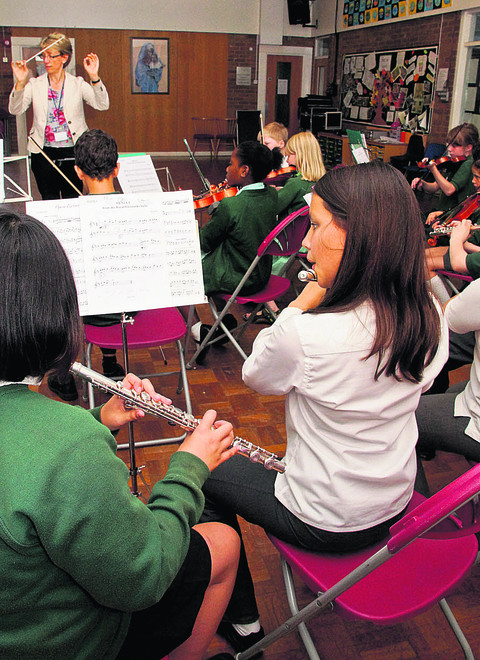 Sue Tomkys conducts the orchestra at St Joseph's Primary School in Headington. Picture: OX53045 Greg Blatchford