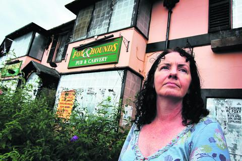 The Rev Jane Sherwood wants the derelict Fox and Hounds building demolished and the site cleared by Tesco