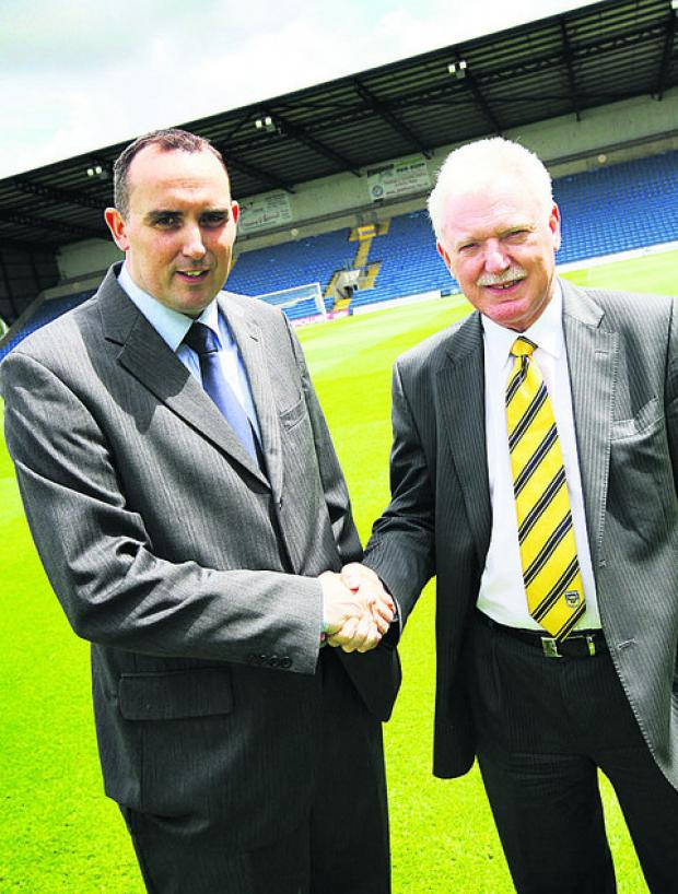 thisisoxfordshire: Departing chairman Kelvin Thomas, left, shakes hands with Ian Lenagan at the Kassam Stadium yesterday