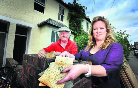 thisisoxfordshire: Builder Gilbert Simms, left, and Lucy's property manager Victoria Birnage with the letter found during renovation of a house in Jericho