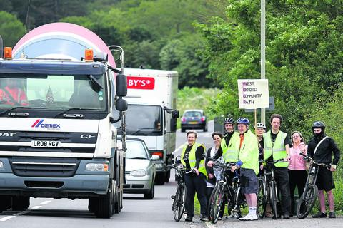 thisisoxfordshire: Members of the Bike Safe, including Ian Leggett, third from right, wait to join the traffic on the busy B4044 between Botley and Eynsham