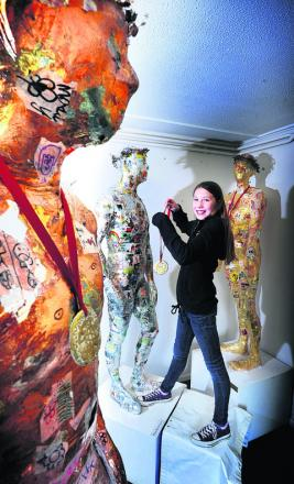 Alissa Clarke with the sporty statues. Picture: OX53123 Jon Lewis