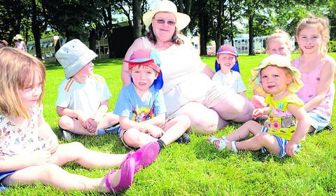 Little Gems manager Paula Foster with, from left, Isla Ford, Leo Ford, Joshua Moran, Paula Foster, Isaac Moran, Darcey Gray (foreground), Georgia Wiggins and Poppy Wiggins