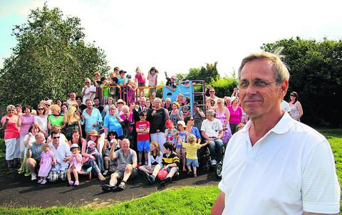 Stan Scott, front, and Old Woodstock families  at the Rosamund Drive play area