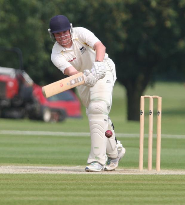 Curtly Slatter hits a boundary during his innings of 89 for Oxfordshire Under 17s against Berkshire at Radley College