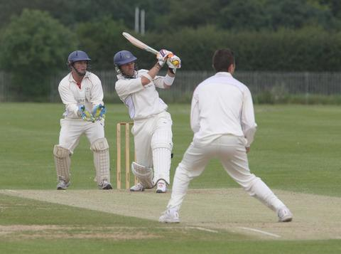 Jamie Perkin strikes a leg-side boundary against Potters Bar