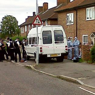 Police and forensic officers outside a house on Launcelot Road, Lewisham, where a teenage boy was found stabbed to death