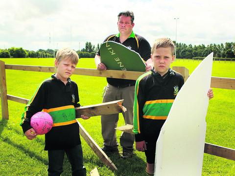 Junior club chairman Jeremy Scott with his sons Charlie, eight, and Henry, right, aged nine, and some of the