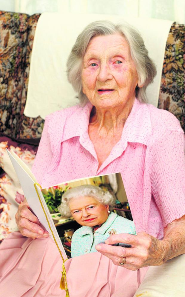 Alice Herbert with her birthday card from The Queen