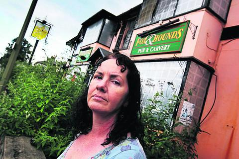 The Rev Jane Sherwood outside the old Fox & Hounds pub