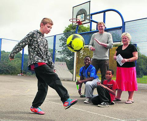 Jack Gifford, 10, shows off his football skills watched by Jem Todd and Sue Holden with Mahiri Clarke, 10, and AJ Hind, eight