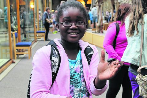 Abena Adu-Boateng, left, from Rose Hill Primary School, enjoys the weird and wonderful exhibits at Oxford University's Museum of Natural History with the Oxford Academy's summer school