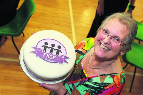 Pearl Livett with a cake for the next fundraising event – a cake sale at County Hall, Oxford