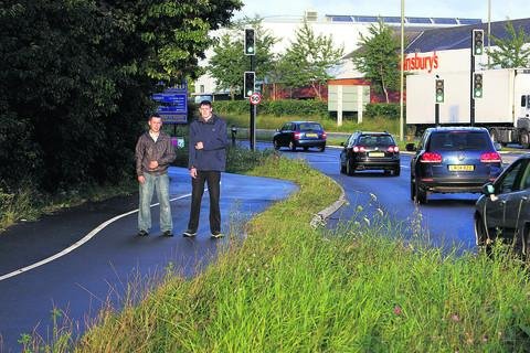 Mark Palmer, left, and Charlie Fisher revisit the Heyford Hill roundabout where a car lost control and smashed sideways into them