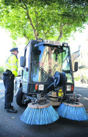 An Oxford City Council roadsweeper is caught doing 29mph in St Giles yesterday. Picture: Marc West