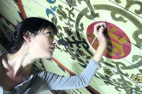Bianca Madden puts some finishing touches to the ceiling at St John The Evangelist Church tower, in James Street, Oxford. Picture: OX54078 Marc West