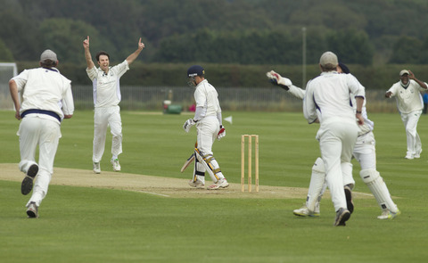 Brad Sutherland celebrates dismissing Leigh Tomlinson, who was caught behind by wicket-keeper Ryan Canning, during Oxford's defeat against Tring Park on Saturday