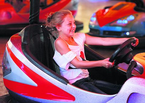 Loren Williams, eight, on the dodgems