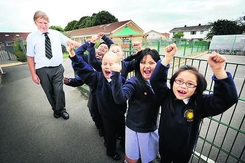 Headteacher Keith Ponsford with excited pupils, from l