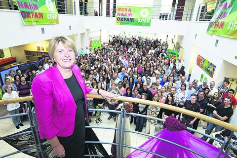 Dame Barbara and staff at Oxfam HQ mark the charity being awarded freedom of city on its 70th birthday earlier this year