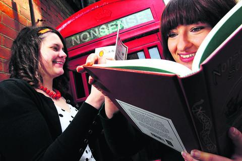 thisisoxfordshire: Rhiannon Jones, right, a staff member at The Story Museum, and Alexandra Coke look at Lear's work as they stand next to the 'nonsense' telephone kiosk. Inset, a line drawing of the artist. Picture: OX54153  Ed Nix