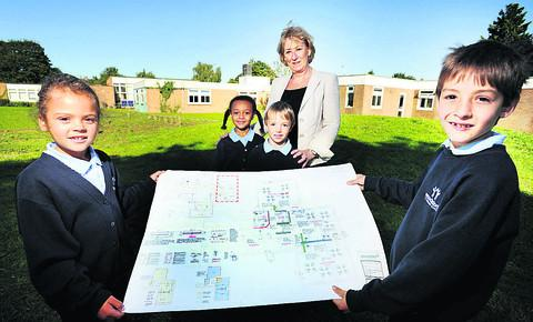 Woodstock Primary headteacher Lisa Rowe shows the plans to pupils, from left, Summer Da