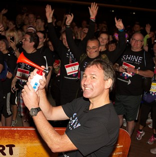 Football legend Bryan Robson starting Cancer Research UK's night-time walking marathon at Old Trafford, Manchester